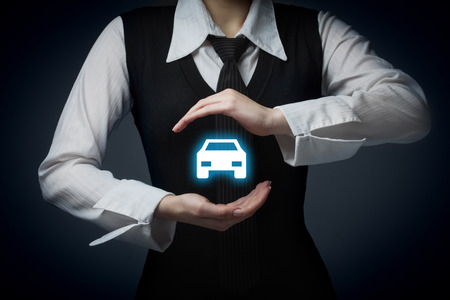 Car (automobile) insurance and collision damage waiver concepts. Businessman with protective gesture and icon of car.