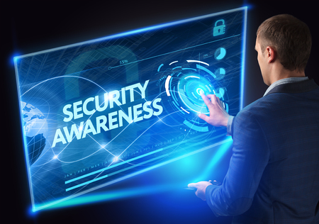 Photo pour Business, Technology, Internet and network concept. Technology future. Young businessman, working on the smartphone of the future, clicks on the virtual display button: Security Awareness - image libre de droit