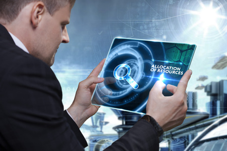 Business, Technology, Internet and network concept. Businessman working on the tablet of the future, select on the virtual display: Allocation of resources