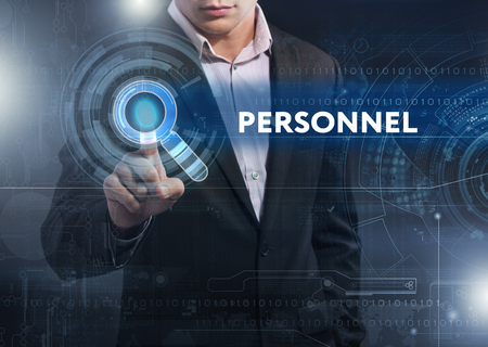 Business, Technology, Internet and network concept. Business man working on the tablet of the future, select on the virtual display: personnel