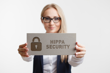 Photo pour Business, Technology, Internet and network concept. Young girl holding a sign with an inscription Hippa Security. - image libre de droit