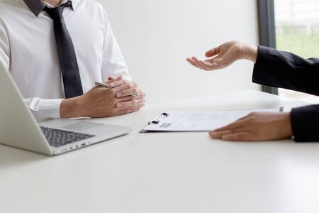 Photo pour Executives are interviewing job applicants and preliminary background checks, candidates are talking about their past work experience, personal managers make hiring decisions. - image libre de droit