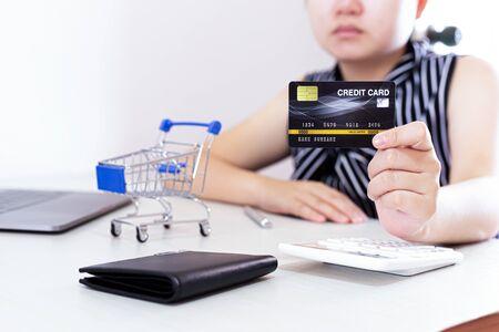 Foto de Close-up of young women using mobile phones and credit cards for online payments, Online shopping concept. - Imagen libre de derechos