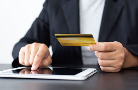 Foto de women use Tablet to register online purchases using credit card payments, Convenience in the world of technology and the internet, Shopping online and banking online concept. - Imagen libre de derechos