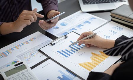 Photo for Business team meeting present, Businessmen and investors are brainstorming and analyzing annual revenue data graphs to present their work to financial managers, Financial accounting, Tex - Royalty Free Image