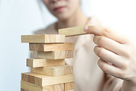Photo pour Planning to reduce investment risks, plan and strategy in business, Establishing a business risk mitigation plan to create stability for the company, Business growth with wooden blocks concept. - image libre de droit