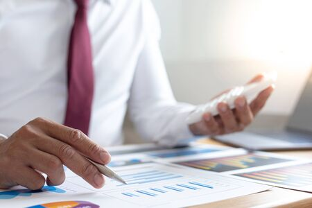 Foto de Accounting businessman are calculating income-expenditure and analyzing real estate investment data, Dedicated to the progress and growth of the company, Financial and tax systems concept. - Imagen libre de derechos