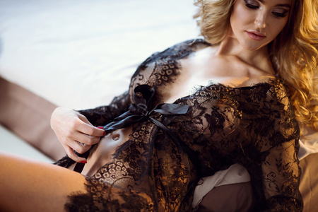 Foto de Beautiful sexy lady in elegant black robe - Imagen libre de derechos