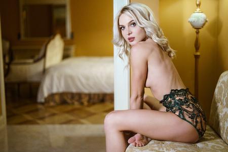 Foto de Beautiful sexy lady in green panties indoors - Imagen libre de derechos