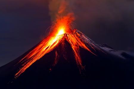 Tungurahua Volcano eruption at night, with snow, Ecuador