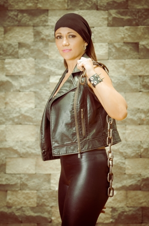 A young and beautiful latina gang woman in leather