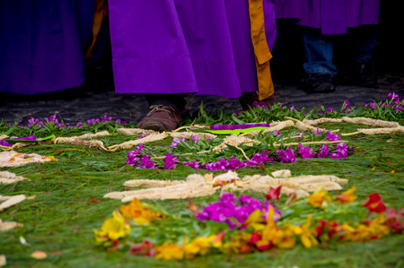 religious procession over handmade easter carpets made from colored sawdust fruits and flowers in antigua guatemala