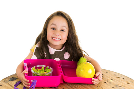 Photo pour Cute little brunette girl with her healthy lunchbox isolated on white - image libre de droit