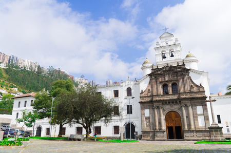 Front entrance to beautiful church of Guapulo located in Quito Ecuador, spanish colonial architecture and blue sky background.