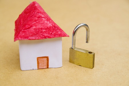 A small and beautifl house model concept of good segurity with an unlock padlock, medium property protection