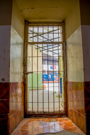 QUITO, ECUADOR - NOVEMBER 23, 2016: Indoor view with a door with bars, in the old prison Penal Garcia Moreno in the city of Quito