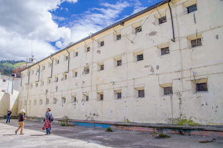 QUITO, ECUADOR - NOVEMBER 23, 2016: Unidentified people taking pictures at indoor in backyard in the old prison Penal Garcia Moreno in the city of Quito
