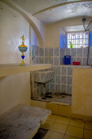 QUITO, ECUADOR - NOVEMBER 23, 2016: Indoor view of old room of prisioners, in the old prison Penal Garcia Moreno in the city of Quito