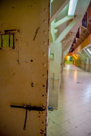 QUITO, ECUADOR - NOVEMBER 23, 2016: Indoor view of old deserted rugged door, metal door in the old prison Penal Garcia Moreno in the city of Quito.