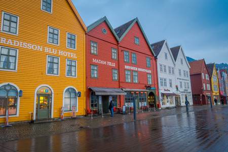 Bergen, Norway - April 03, 2018: Norwegian traditional wooden house, Bryggen, is one of a world heritage site, it contains colorful traditional wooden building lie along the lake