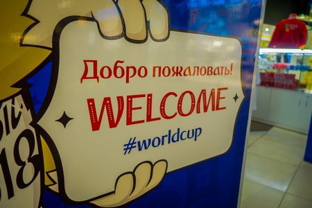 ST. PETERSBURG, RUSSIA, 02 MAY 2018: Close up of selective focus of the hands of the official mascot of the 2018 FIFA World Cup wolf Zabivaka holding a welcome sign in the picture
