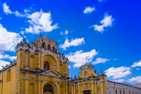 Ciudad de Guatemala, Guatemala, April, 25, 2018: View of Hermano Pedro church, typical street scene in Spanish colonial town of Antigua in Antigua