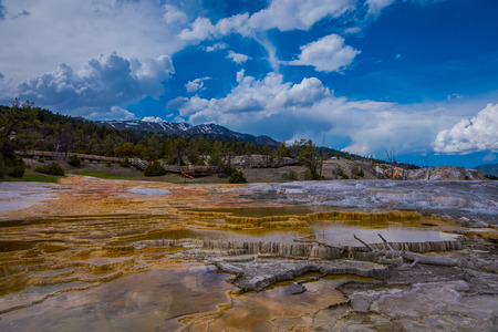 Mesa rock patterns at mamoth hot springs in Yellowstone National Park, in beautiful sunny day and blue sky