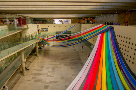 SANTIAGO, CHILE - SEPTEMBER 13, 2018: Costanera Center mall interior, with some rainbow structures hanging in top of the mall in Santiago of Chile