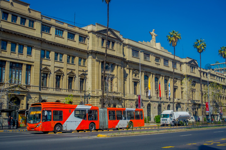 SANTIAGO, CHILE - SEPTEMBER 13, 2018: Outdoor view of huge buildings in Barrio Lastarria with a bus in front of the building in Santiago, Chile