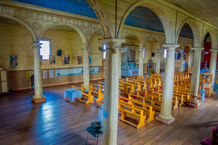 CHILOE, CHILE - SEPTEMBER, 27, 2018: Indoor view of wooden made church in Chonchi, Chiloe island in Chile. Nuestra Senora del Rosario