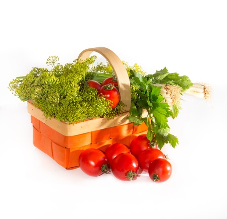 Composition with tomatoes and herbs in a basket for canning   parsley, onion, horseradish の写真素材