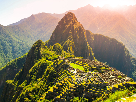 Ancient Inca City of Machu Picchu illuminated by sun. Ruins of Incan Lost city in Peruvian jungle. UNESCO World Heritage site, Peru, South America.