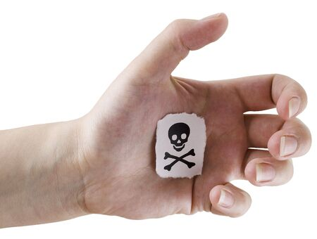 Fragmentary piece of paper with drawn jolly Roger on a palm