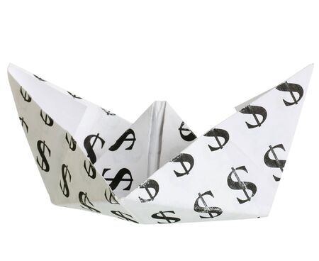 Toy boat built from sheet of paper with typed on him symbol of the dollar