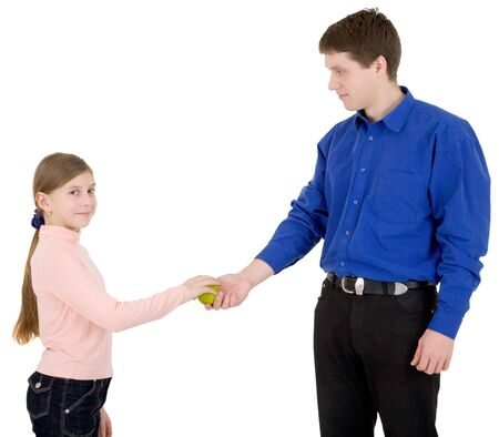 Man give green apple to the girl on white