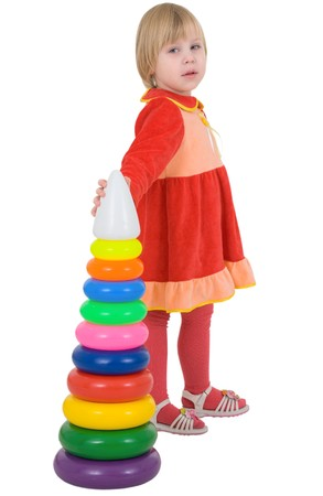 Girl in the red dress with toy on a white background
