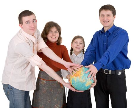 Man,woman and child hold globe on white