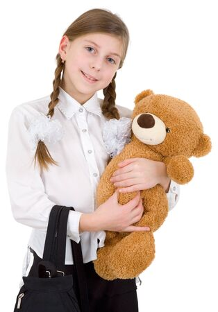 Schoolgirl with bear on a white background