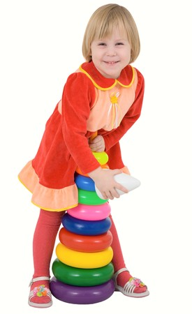 Child in the red dress with toy on a white
