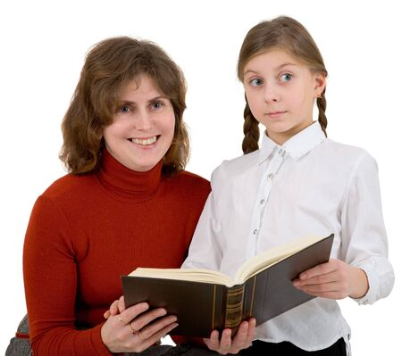 Woman with girl reading book on white