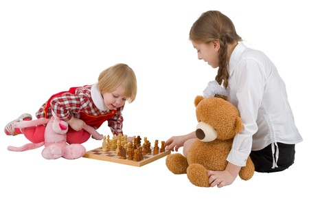 Girls play chess on the white background