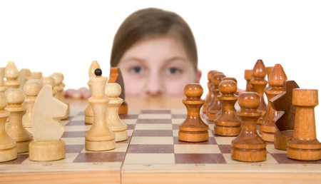 Girl and chess on a white background