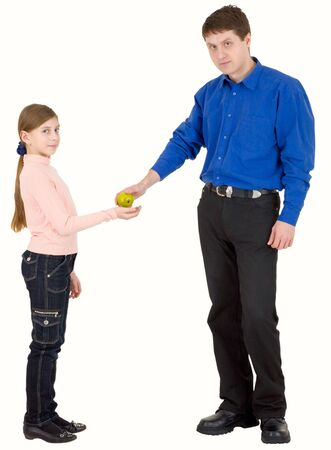 Man give green apple to girl on white