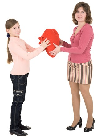 Woman give heart to girl on a white background