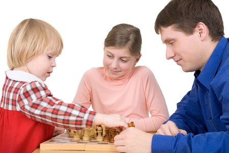 Man and children play chess on white