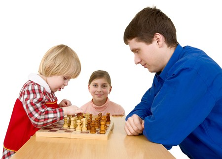 Man and childs play chess on a white background