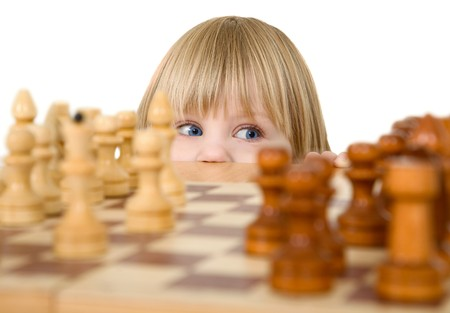 Child and chess on a white background