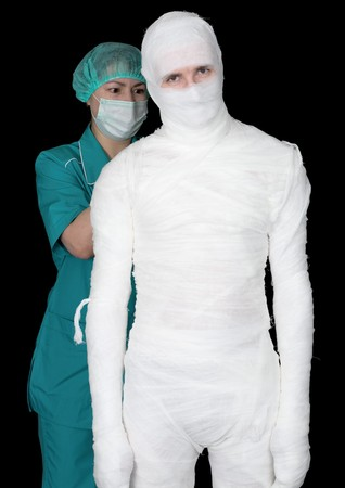 Man in bandage and nurse on black background