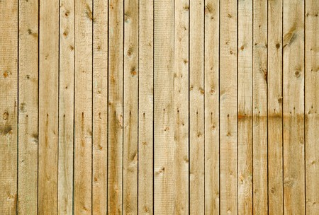 Wall covered with rough pine boards - a wooden background
