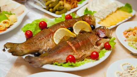 Dish of delicious fried fish on the table